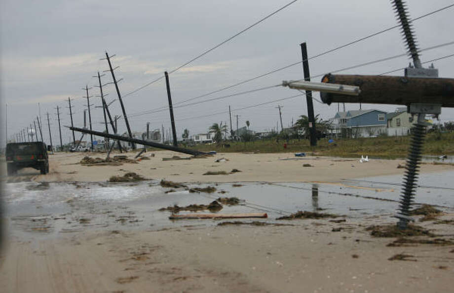 Light poles are on the ground on west Galveston Island on Sunday. Photo: Sharon Steinmann, Chronicle