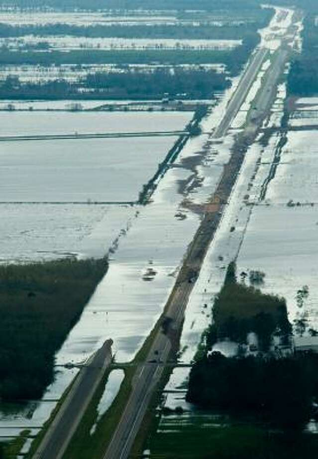 Floodwaters caused by Hurricane Ike cover Texas Highway 73 near Winnie, Texas, on Sunday. Photo: Smiley N. Pool, Chronicle