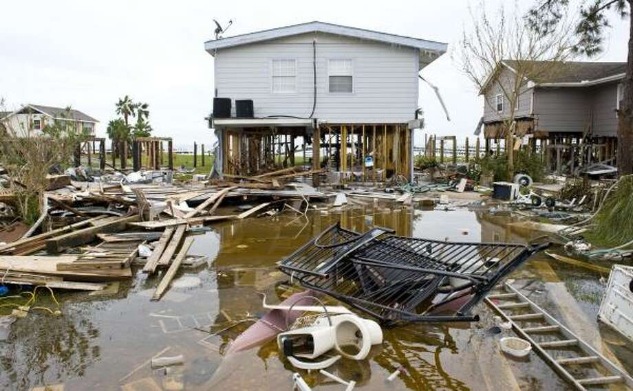 A heavily damaged home in San Leon, Texas. San Leon is located on Galveston Bay. Photo: Dave Einsel, Getty Images