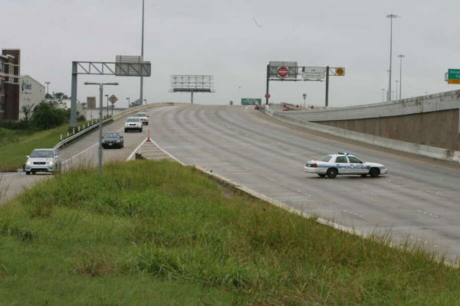 Cars on Interstate 10 exit at Taylor Street Sunday in Houston because of the flooded freeway. Photo: Jill Karnicki