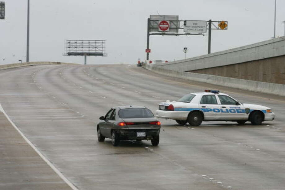 Floodwaters shut down Interstate 10 at Taylor Street on Sunday in Houston. Photo: Jill Karnicki, Chronicle