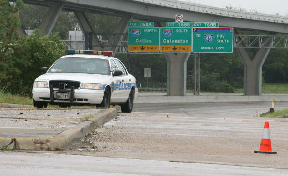 Police block access to the flooded Interstate 10 at Taylor Street Sunday. Photo: Jill Karnicki, Chronicle