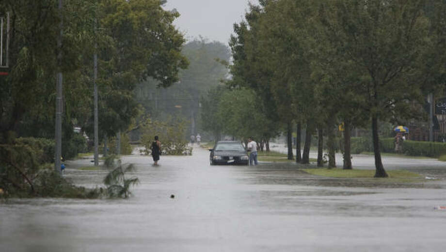 A car is stranded in the flooded streets Sunday in the Westview Terrace subdivision after Hurricane Ike moved through the area. Photo: James Nielsen, Chronicle