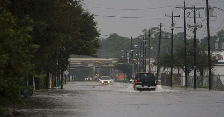 Silber Street is flooded near Interstate 10 by heavy rains Sunday  just a day after Hurricane Ike moved through the area. Photo: James Nielsen, Chronicle