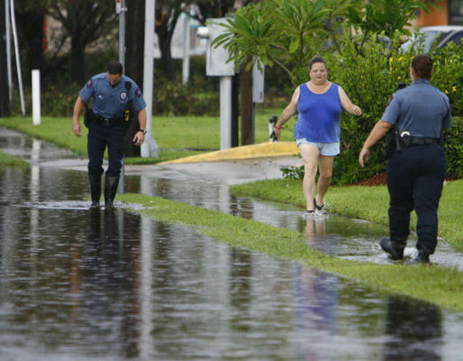 Spots such as this one in League City flood after a downpour hit the area Sunday. Photo: Nick De La Torre, HOUSTON CHRONICLE
