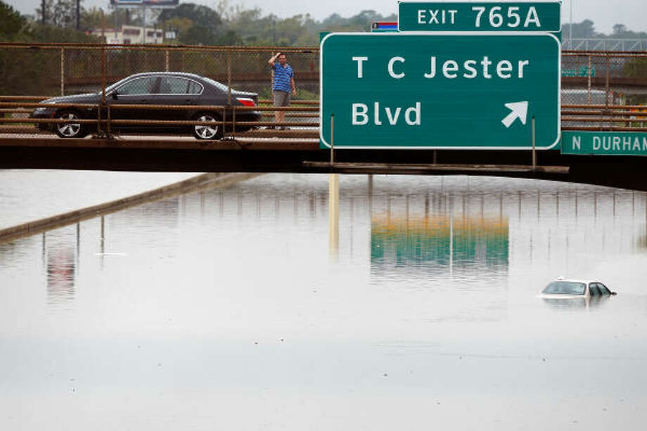 A motorist looks at the flooded Interstate 10 Sunday in Houston. Photo: Chris Graythen, Getty Images