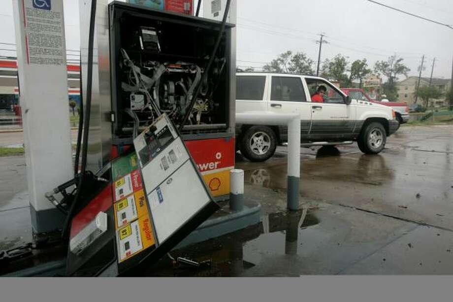 A damaged gas pump is seen Sunday in Houston  after Hurricane Ike swept through. Photo: Marcio Jose Sanchez, AP