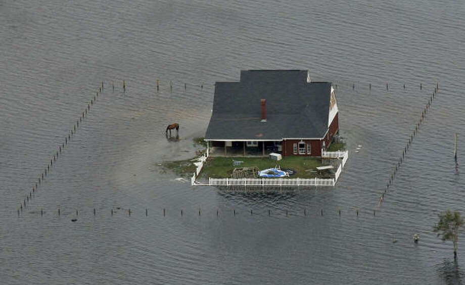 Flood waters engulf a home after Hurricane Ike near Winnie, Texas. Photo: David J. Phillip, Getty Images