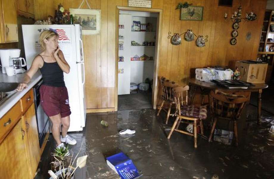 Kay Townsend looks at her home that was flooded after Hurricane Ike in Orange, Texas, Sunday. Photo: Alex Brandon, AP