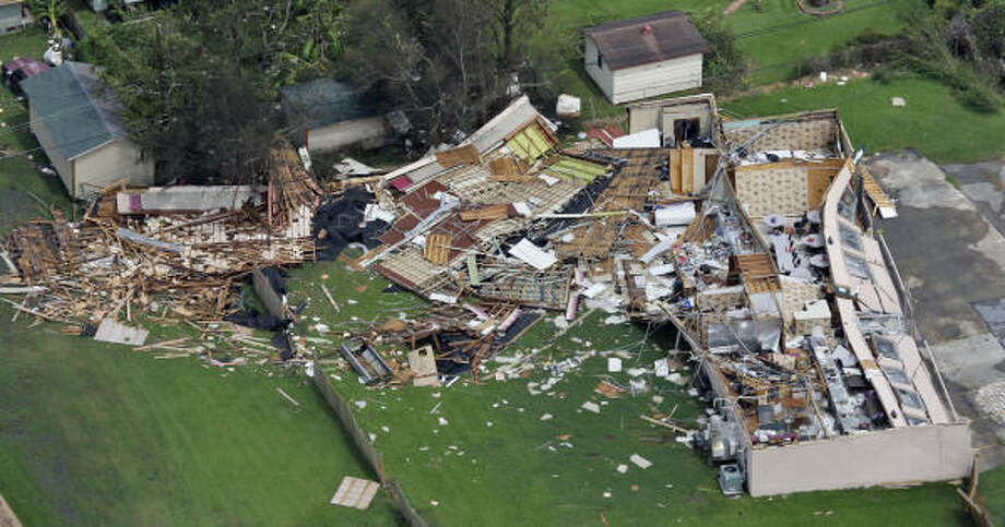 A collapsed building's debris is scattered near Winnie, Texas, Sudnay. Photo: POOL, AFP/Getty Images
