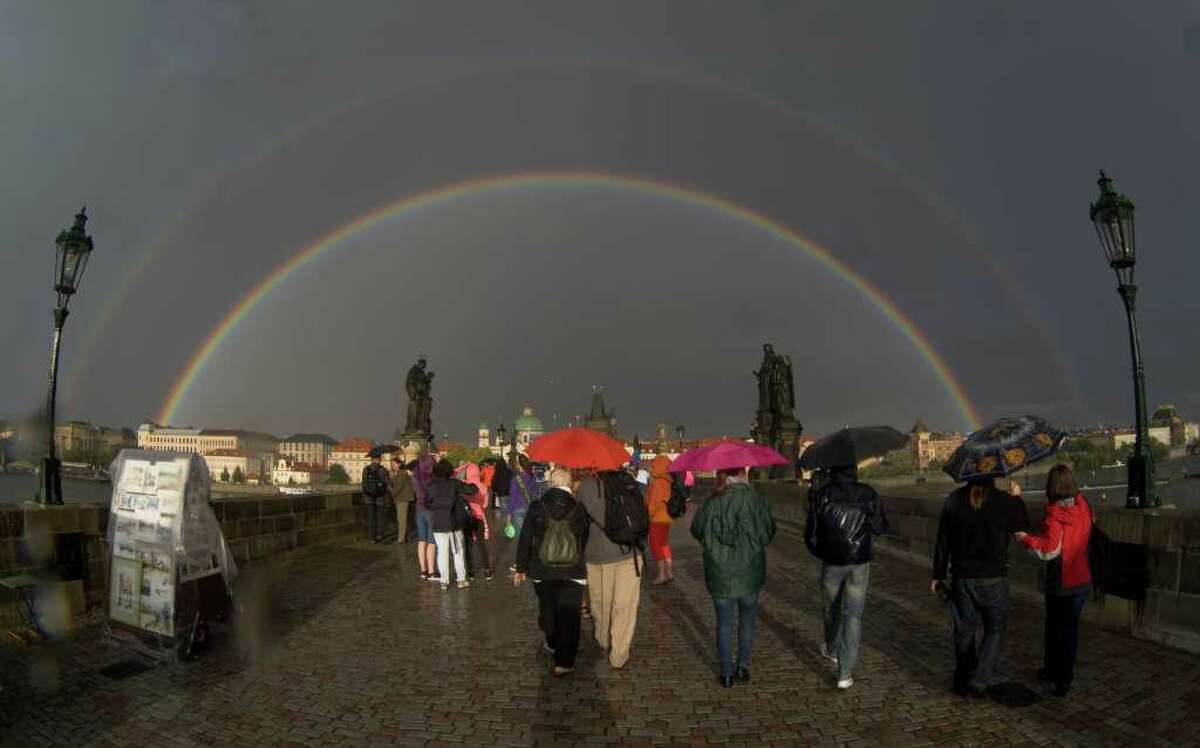 A rainbow is seen above the medieval Charles Bridge in Prague.
