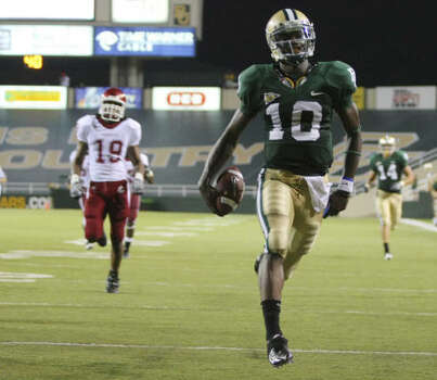 Baylor quarterback Robert Griffin ran for 217 yards and two touchdowns, including this 58-yarder, in Friday's win. Baylor had two 100-yard runners in the game; Jay Fniley had 119 on 10 carries. Photo: Jerry Larson, AP