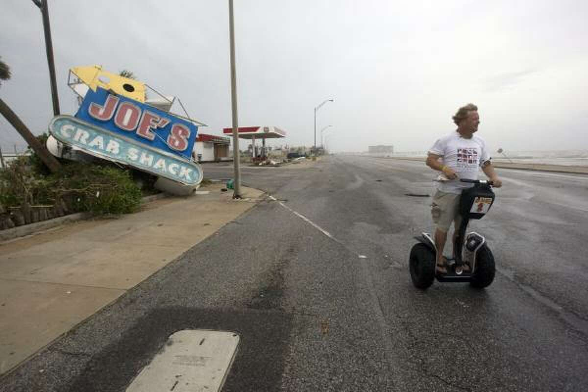 Daryl Secteau of Galveston rides on a Segway assessing the damage Hurricane Ike caused along Seawall Boulevard.