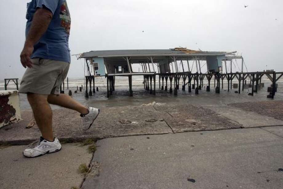 Hurricane Ike left the remnants of Murdock's Pier standing along Seawall Boulevard. Photo: Johnny Hanson, Chronicle