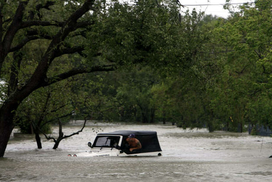Chris Symank sits in his flooded jeep. Photo: Eric Kayne, Chronicle