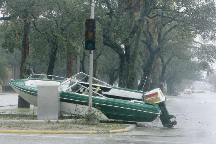 A boat lies in a street after Hurricane Ike hit the Texas coast. Photo: Matt Slocum, Associated Press