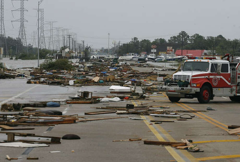 Debris covers Highway 146 at the Galveston County and Harris County line in Seabrook. Photo: Kevin M. Cox, Galveston County Daily News