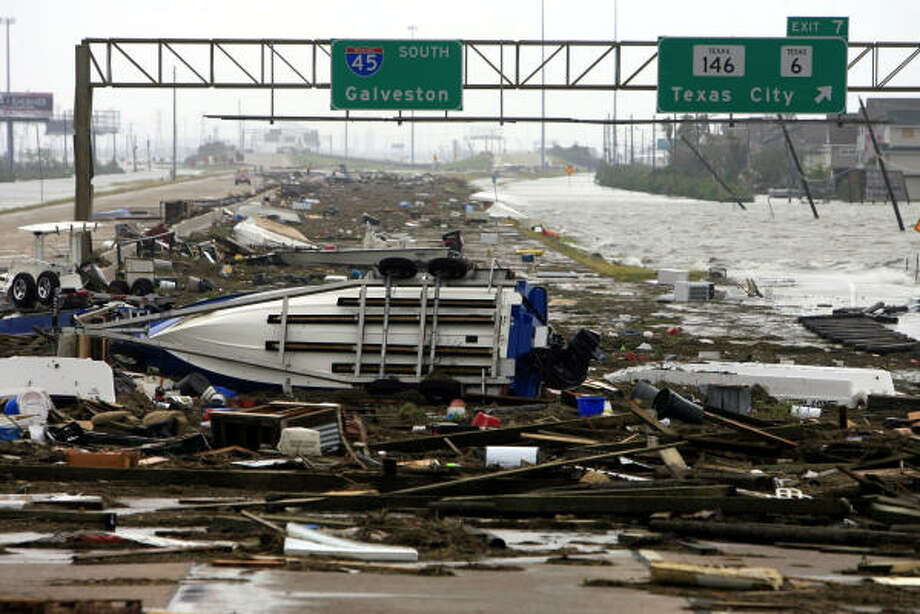 Debris lines the southbound lanes of I-45 leading to Galveston after Hurricane Ike struck the area the night before. Photo: Eric Kayne, Chronicle