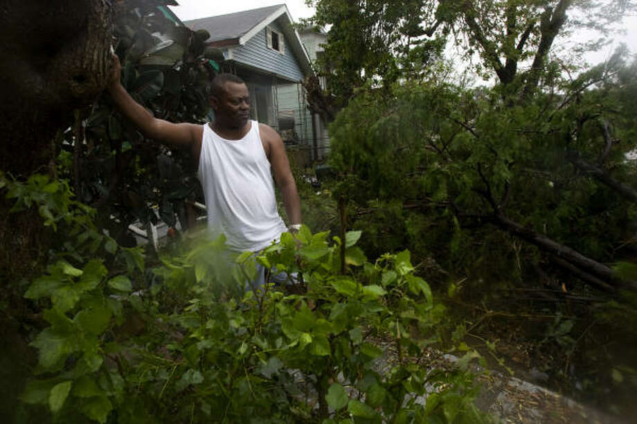 Richard Gonzales found felled trees outside his home after Ike had passed through his neighborhood. Photo: Johnny Hanson, Chronicle