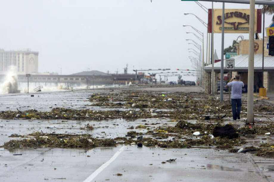Debris on the Seawall Boulevard is caused by early waves breeching the Seawall on Galveston Island as Hurricane Ike approached Galveston on Friday. Photo: Johnny Hanson, Chronicle