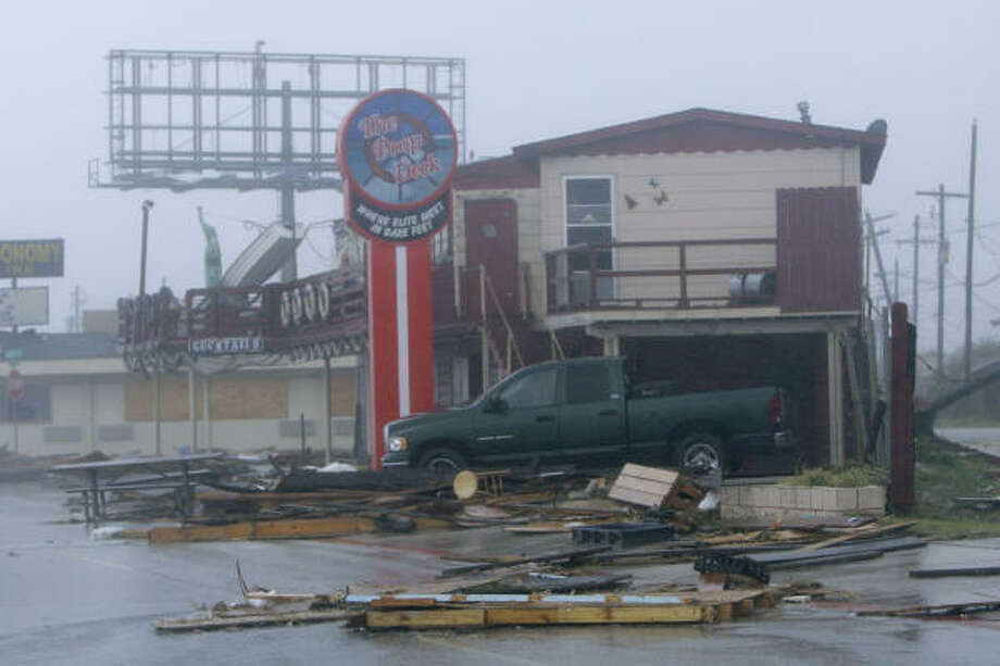 Hurricane damage at this Galveston cafe is seen this morning. Photo: Matt Slocum, Associated Press