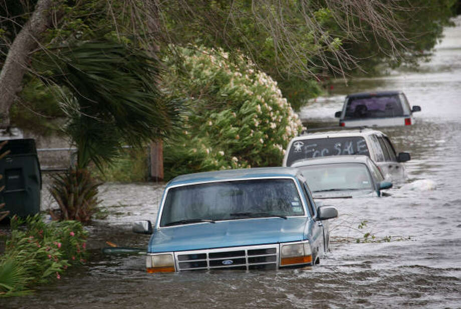 Vehicles flooded by the tidal surge from Hurricane Ike sit along a street Friday in Galveston. Photo: Scott Olson, Getty Images