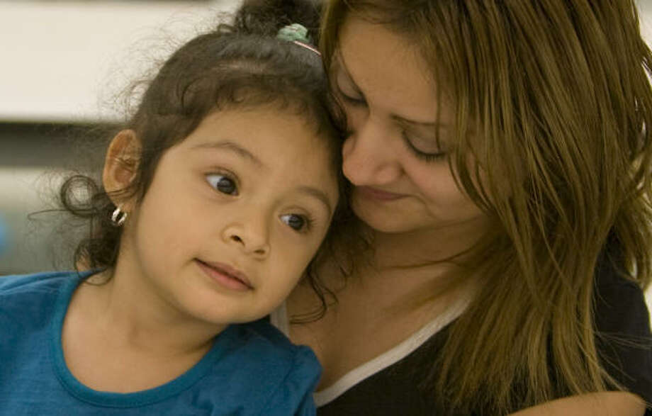 Lilianna Gutierrez, 2, rests her head against her aunt, Rosa Gutierrez, at the shelter in Huntsville. Both were at the shelter with other family members from Angleton. Photo: Steve Campbell, Chronicle