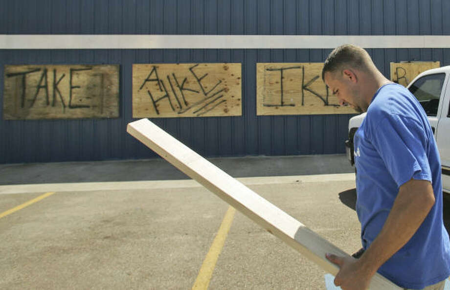 Eirc Mercer finishes up boarding up his business in preparation for hurricane Ike in Victoria. Photo: LM Otero, AP
