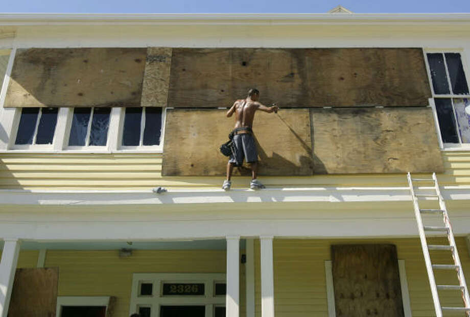 John Vasquez boards up a Galveston home in preparation for Hurricane Ike's landfall. Photo: Matt Slocum, AP