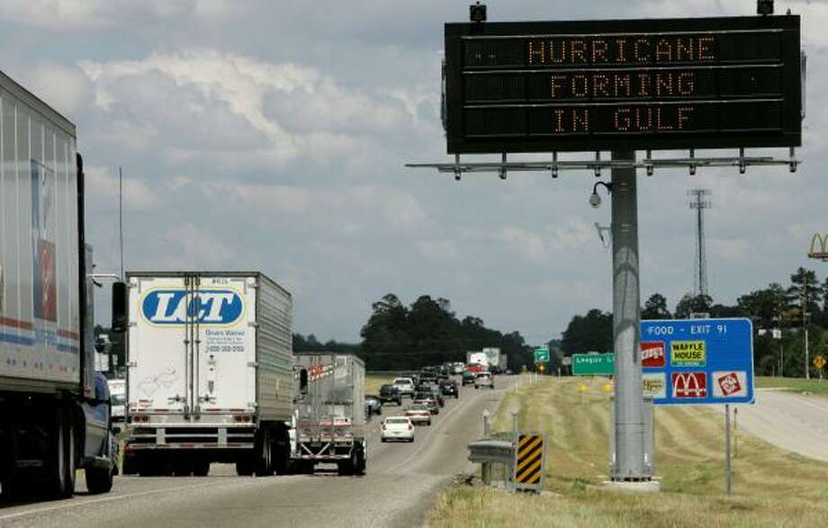 "A Texas Department of Transportation sign reads, ""Hurricane Forming in Gulf"", as a steady flow of heavy traffic makes it's way north on Interstate 45 in Conroe. Photo: Tony Gutierrez, AP"