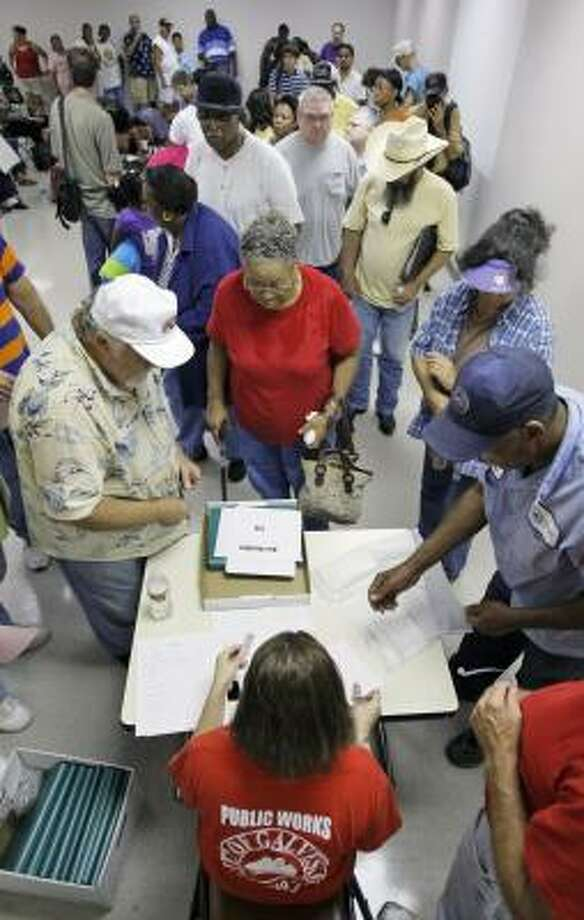 Galveston Island evacuees line up to register for an evacuation bus. Photo: David J. Phillip, AP
