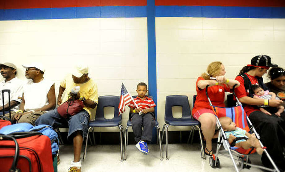 Four-year-old Damien Anderson waits to evacuate in advance of Hurricane Ike with other special-needs residents at West Brook High School in Beaumont. Photo: Tammy McKinley, AP