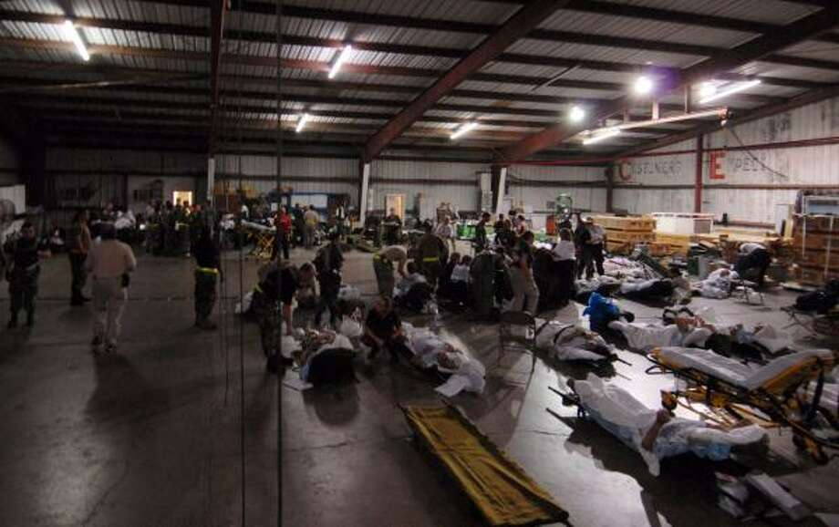 The U.S. military personnel prepare medical patients for evacuation from Corpus Christi to a medical facility in Dallas. Photo: AP
