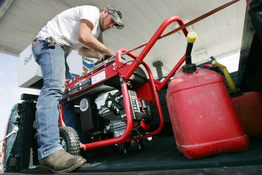 Phillip Winter of Corpus Christi fills up his generator and two extra fuel containers with gas Sept. 10 as he makes preparations for riding out the storm in Corpus Christi. Photo: Michael Zamora, Corpus Christi Caller-Times