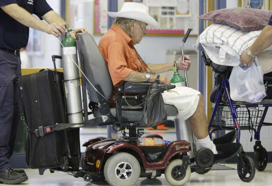 Earl Barnes waits to be evacuated at the Oveal Williams Senior Center  in Corpus Christi on Wednesday. Photo: Eric Gay, AP