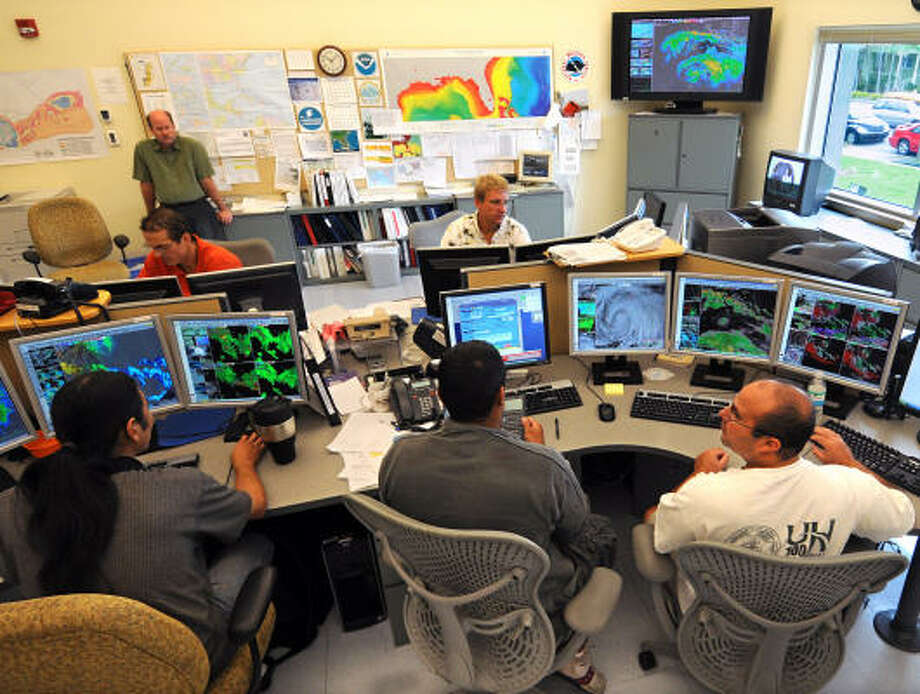 Meteorologists at the Key West National Weather Service office monitor Hurricane Ike Tuesday in Key West, Fla. Ike's devastating core passed well to the south of Key West, sparing the Florida Keys of a major impact. Photo: Handout, Getty Images