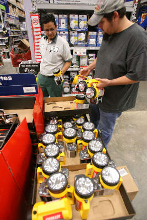 Jose Sosa and Oscar Guerra check out flashlights at the Lowe's store in Corpus Christi as they prepare for Hurricane Ike on Tuesday. Photo: Todd Yates, AP