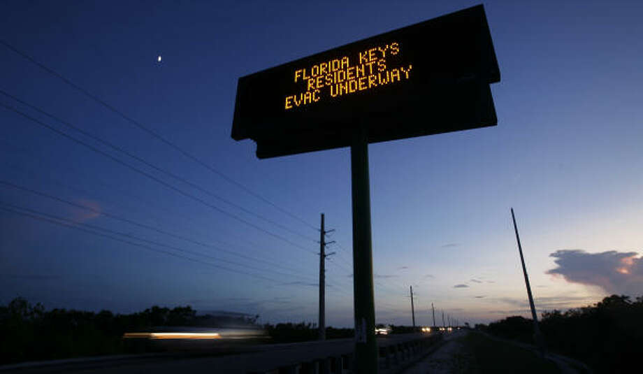 "Cars drive past a sign that reads "" Florida Keys Residents Evac Underway"" Sunday night, Sept. 7,near Big Pine, Fla.  Sunday's forecast called for Ike's eye to pass south of the Florida Keys, where an evacuation has been ordered but many residents were planning to take their chances. Photo: J. Pat Carter, AP"