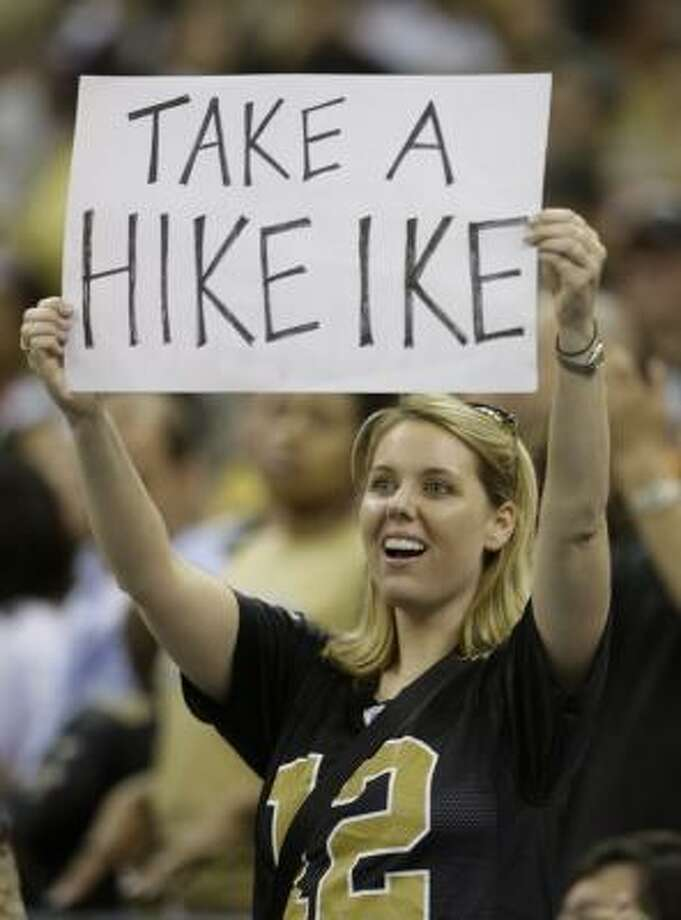 Fan Suzanne Alford shows her disdain for Hurricane Ike at the New Orleans Saints-Tampa Bay Buccaneers football game in New Orleans on Sept. 7. Photo: Alex Brandon, AP