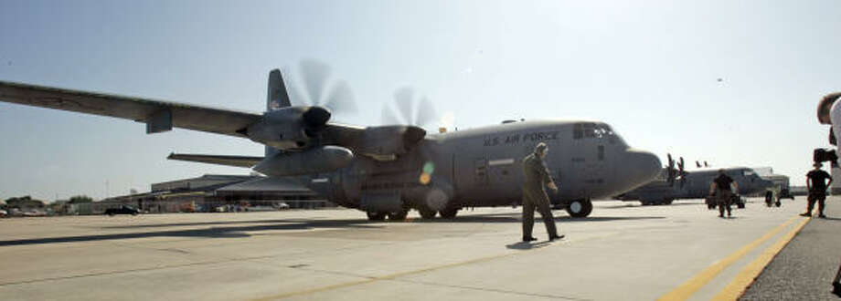 Loaded with meteorological data-gathering instruments, this Air Force Reserve C-130J readies for a flight into Hurricane Ike. Photo: Rogelio V. Solis, AP