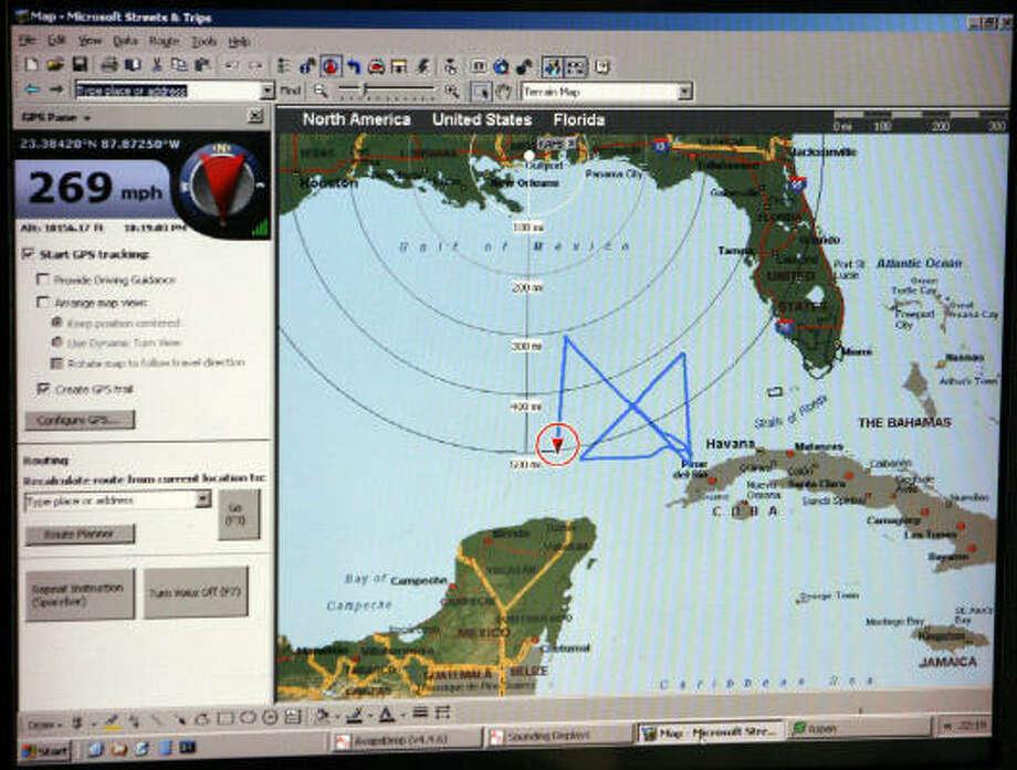 A computer screen shows the X-pattern the Hurricane Hunter aircraft has flown through Hurricane Ike. Photo: Rogelio V. Solis, AP