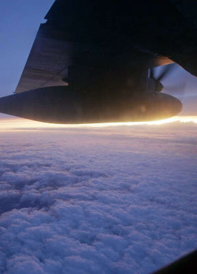 A setting sun highlights the propeller blades of the Hurricane Hunters C-130J aircraft as it completes its mission over Hurricane Ike on Sept. 10 in the Gulf of Mexico. Photo: Rogelio V. Solis, AP