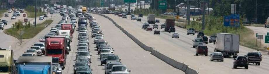 Traffic heads north on Interstate 45 near Spring Stuebner on Thursday afternoon after coastal areas and parts of Harris County were told to evacuate. Photo: STEVE CAMPBELL, CHRONICLE
