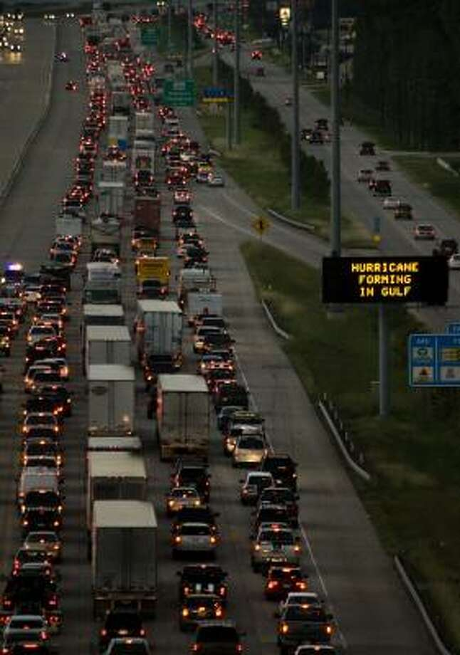 TRAFFIC backs up on Interstate 45 northbound near The Woodlands on Thursday as residents evacuate the greater Houston area in anticipation of Hurricane Ike. Thousands joined the exodus from mandatory evacuation zones, but others, not ordered to leave, opted to retreat anyway. Photo: SMILEY N. POOL, CHRONICLE