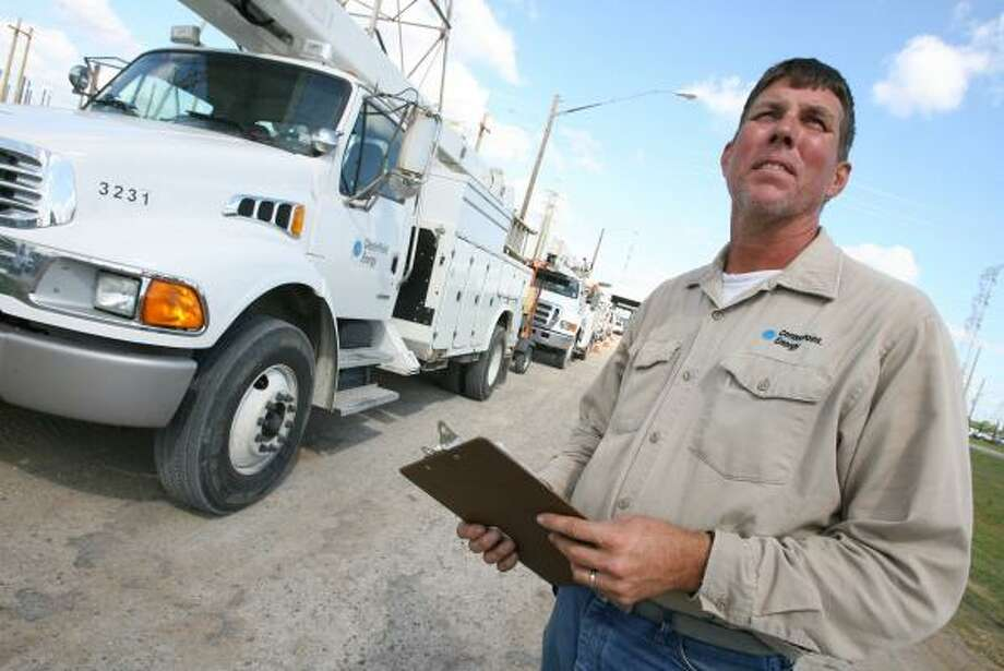 CenterPoint lineman James Hefner checks equipment that was moved from low-lying areas to the company's South Main facility. Photo: BILL OLIVE, FOR THE CHRONICLE