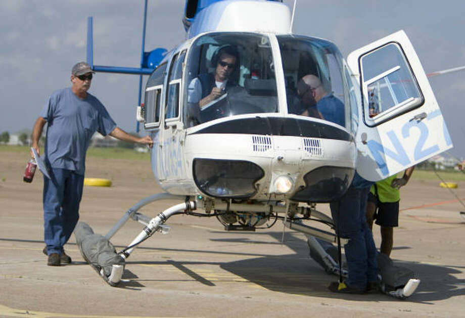Dave Thornton leaves a helicopter at the Galveston airport after he and other oil platform workers evacuate on Sept. 10. Photo: Nick De La Torre, CHRONICLE
