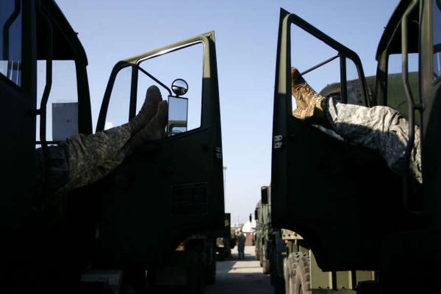 Army National Guard soldiers sleep in their trucks during staging Sept. 10 in Houston.