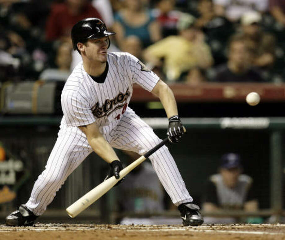 Roy Oswalt lays down a sacrifice bunt to bring home Reggie Abercrombie against the Pittsburgh Pirates in the third inning on Thursday at Minute Maid Park. Photo: Eric Kayne, Chronicle