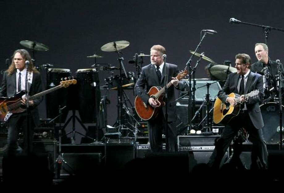 Members of the Eagles perform Tuesday night at the Toyota Center. The group has a second show Thursday at the venue. Photo: BILL OLIVE, CHRONICLE