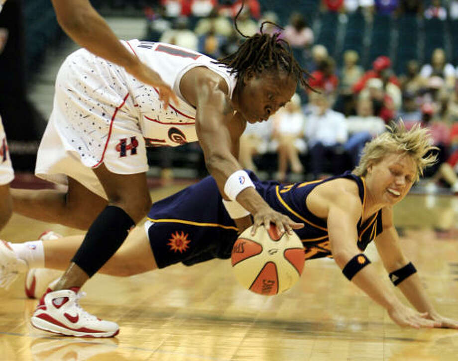 Connecticut's Erin Phillips and the Comet's  Shanon Johnson fight for the ball in the first half. Photo: Eric Kayne, Chronicle